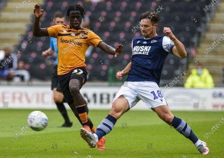 Ryan Leonard of Millwall clears from Leo Da Silva Lopes of Hull City