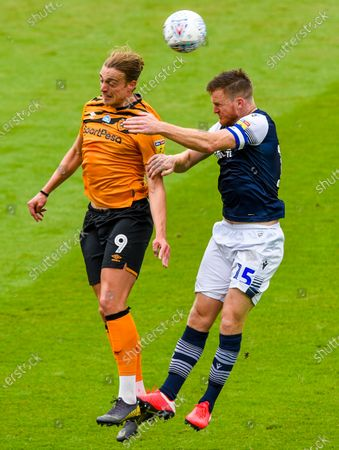 Tom Eaves of Hull City and Jake Cooper of Millwall