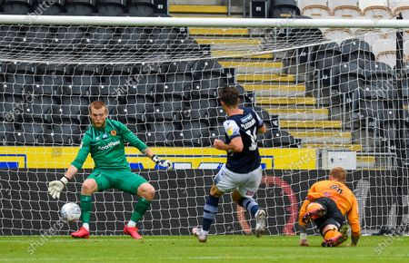 Goalkeeper George Long of Hull City saves from Ryan Leonard of Millwall just before half time