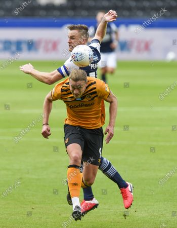 Tom Eaves of Hull City and Alex Pearce of Millwall