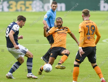 Kevin Stewart of Hull City appears late on Ryan Leonard of Millwall