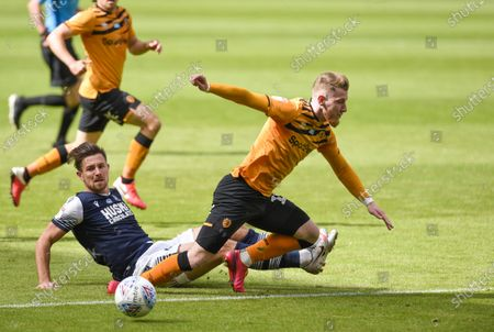Ryan Leonard of Millwall tackles Josh Bowler of Hull City on the edge of the penalty area