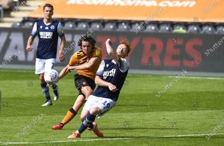 George Honeyman of Hull City shoots at goal as Ryan Woods of Millwall blocks