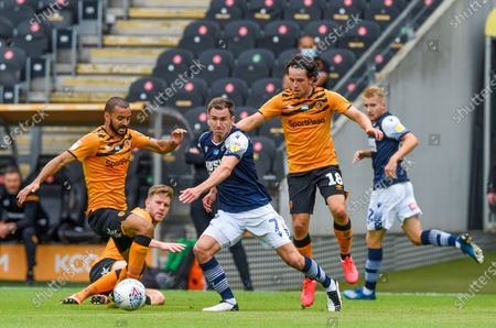 Kevin Stewart of Hull City and George Honeyman of Hull City try to stop Jed Wallace of Millwall
