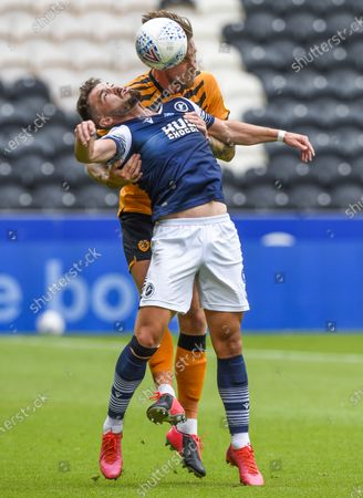 Tom Bradshaw of Millwall and Angus MacDonald of Hull City