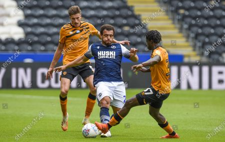 Mason Bennett of Millwall and Leo Da Silva Lopes and Reece Burke of Hull City