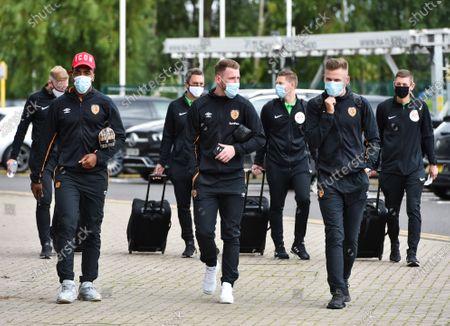 Mallik Wilks, Josh Bowler and James Scott of Hull City arrive for the game