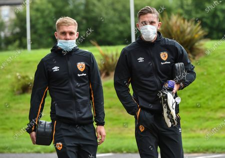 Daniel Batty of Hull City and Angus MacDonald arrive for the game