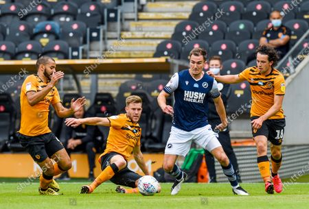 Jed Wallace of Millwall is hassled by George Honeyman, Callum Elder and Kevin Stewart of Hull City