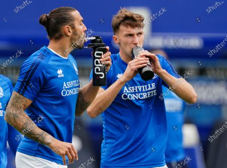 Geoff Cameron of QPR and Conor Masterson of QPR drink from an IPRO water bottles