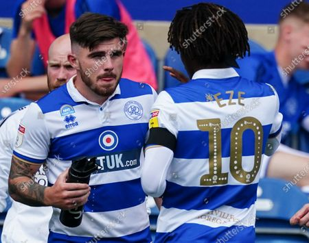 Ryan Manning of QPR talks to Eberechi Eze of QPR during a break in play