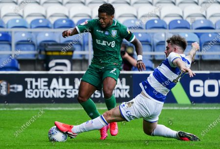 Ryan Manning of QPR slide tackles Kadeem Harris of Sheffield Wednesday