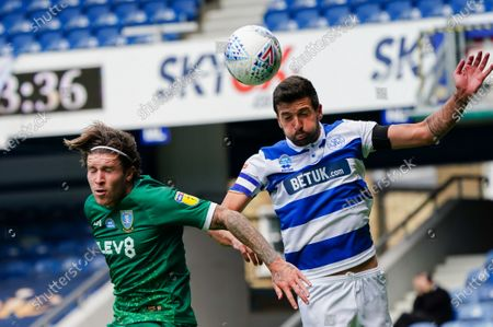 Josh Windass of Sheffield Wednesday and Yoann Barbet of QPR battle for the ball