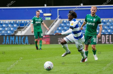 Eberechi Eze of QPR runs for the ball ahead of Barry Bannan of Sheffield Wednesday