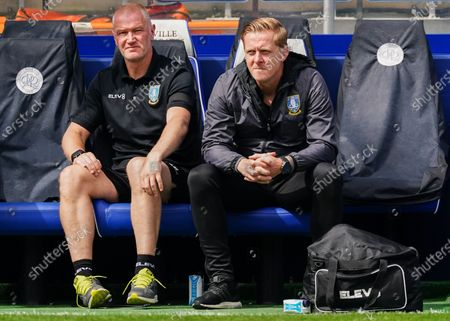 Sheffield Wednesday Manager Garry Monk sits alongside Coach Lee Bullen