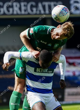 Barry Bannan of Sheffield Wednesday climbs on top of Bright Osayi-Samuel of QPR for an aerial challenge