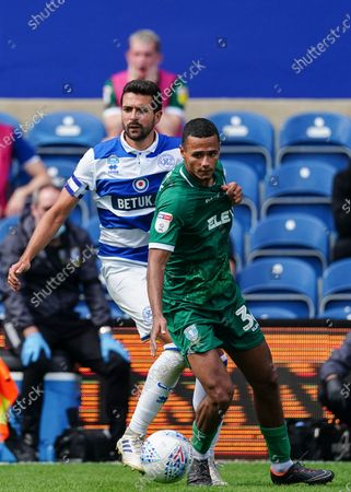 Yoann Barbet of QPR plays the ball around Alessio Da Cruz of Sheffield Wednesday