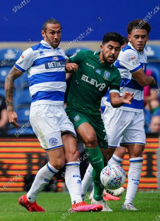 Geoff Cameron of QPR collides with Massimo Luongo of Sheffield Wednesday