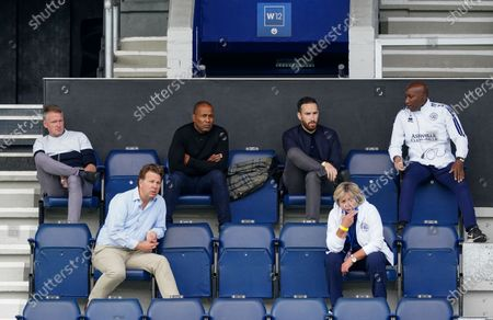 QPR coaching staff and VIP guests watch the game whilst staying social distanced with one another