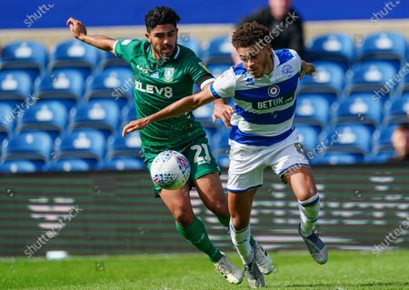 Luke Amos of QPR is challenged by Massimo Luongo of Sheffield Wednesday
