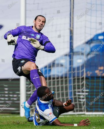 Aramide Oteh of QPR collides with Joe Wildsmith of Sheffield Wednesday