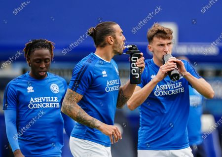 Geogg Cameron of QPR and Conor Masterson of QPR drink from an IPRO water bottles