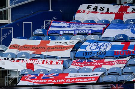 QPR flags rest on the seats in the stands