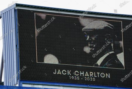 The big screen displays a portrait of Jack Charlton as a minute of silence is held to pay tribute to Jack Charlton from the players and officials