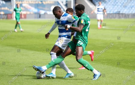 Dominic Iorfa of Sheffield Wednesday tackles Bright Osayi-Samuel of QPR