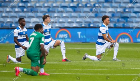 Players take the knee  - Luke Amos of QPR (R)