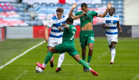 Conor Masterson of QPR  tackled by Kadeem Harris of Sheffield Wednesday