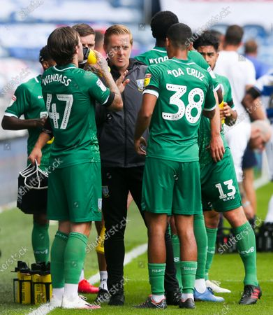 Garry Monk Manager of Sheffield Wednesday talks to his team during the drinks' break