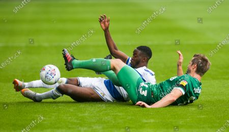 Olamide Shodipo of QPR  & Julian Borner of Sheffield Wednesday slide into a tackle