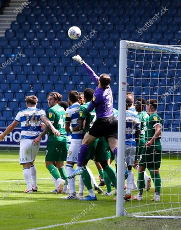 Both teams crowd the goal mouth for a corner - Joe Wildsmith goalkeeper of Sheffield Wednesday punches clear