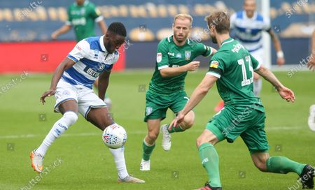 Olamide Shodipo of QPR  takes on Julian Borner of Sheffield Wednesday