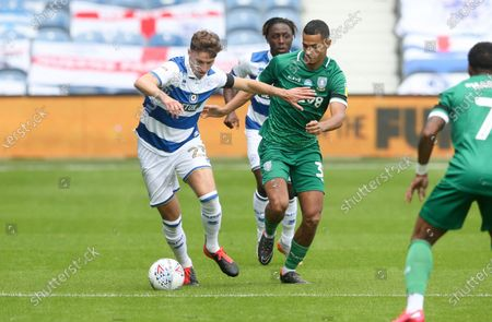 Conor Masterson of QPR  takes on Alessio da Cruz of Sheffield Wednesday