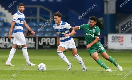 Luke Amos of QPR holds off Massimo Luongo of Sheffield Wednesday