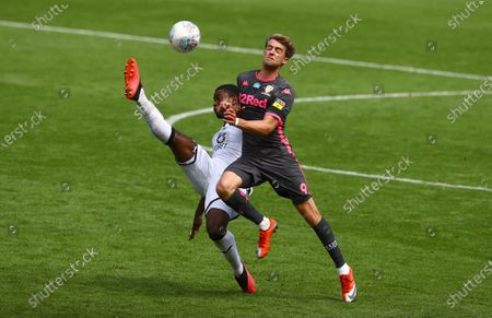 Marc Guehi of Swansea City and Patrick Bamford of Leeds United in action