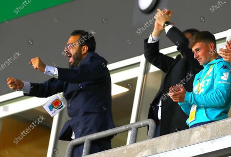 Leeds United director of football Victor Orta celebrates wildly after full time