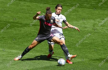 Kalvin Phillips of Leeds United and Conor Gallagher of Swansea City in action