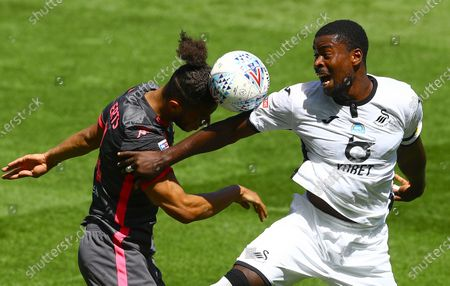 Tyler Roberts of Leeds United and Marc Guehi of Swansea City in action