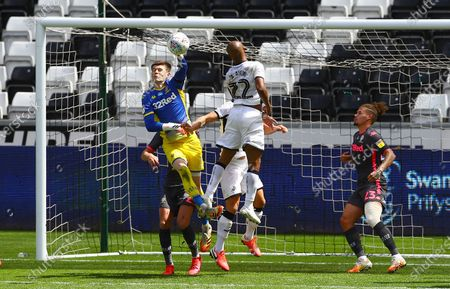 Illan Meslier of Leeds United punches clear
