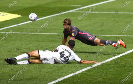 Patrick Bamford of Leeds United sees a diving header saved by Freddie Woodman of Swansea City