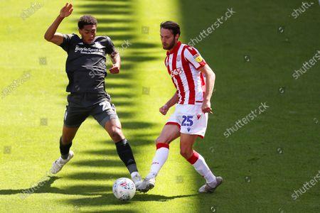 Jude Bellingham of Birmingham City and NIck Powell of Stoke City
