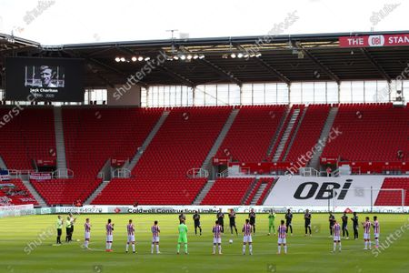 Stoke City and Birmingham City players take part in a minutes applause before kick off in memory of Jack Charlton