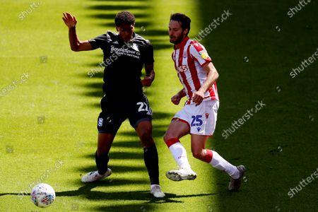 Nick Powell of Stoke City and Jude Bellingham of Birmingham City