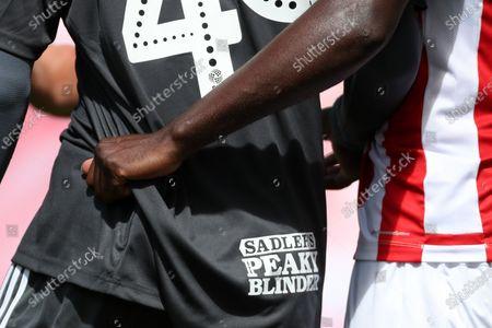 Bruno Martins Indi of Stoke City gets a grip of the shirt of Jayden Reid of Birmingham City
