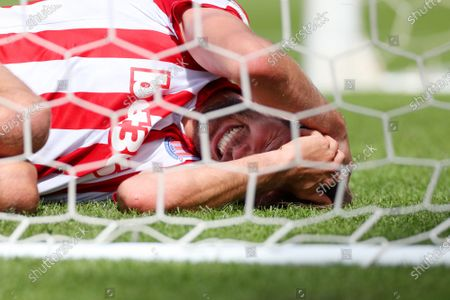 Nick Powell of Stoke City reacts after receiving a knock to the head