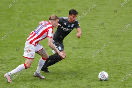 Maxime Colin of Birmingham City and James McClean of Stoke City