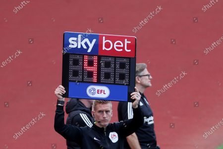 The fourth official displays the SKY BET branded substitutes board